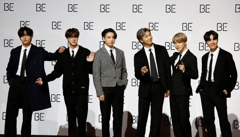 Members of K-pop boy band BTS pose for photographs during a news conference promoting their new album