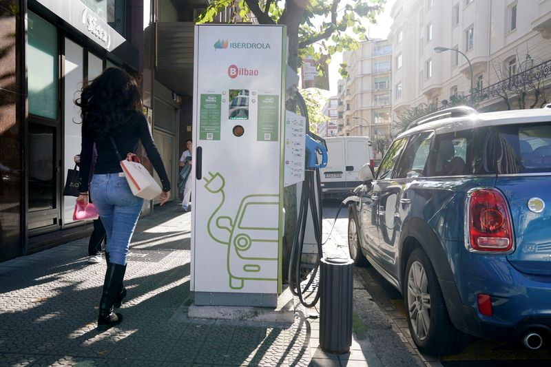 FILE PHOTO: An electric car is charged from an Iberdrola electric car charging station in central Bilbao