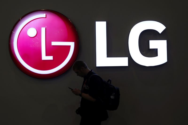 A man walks past an LG logo at the Mobile World Congress in Barcelona