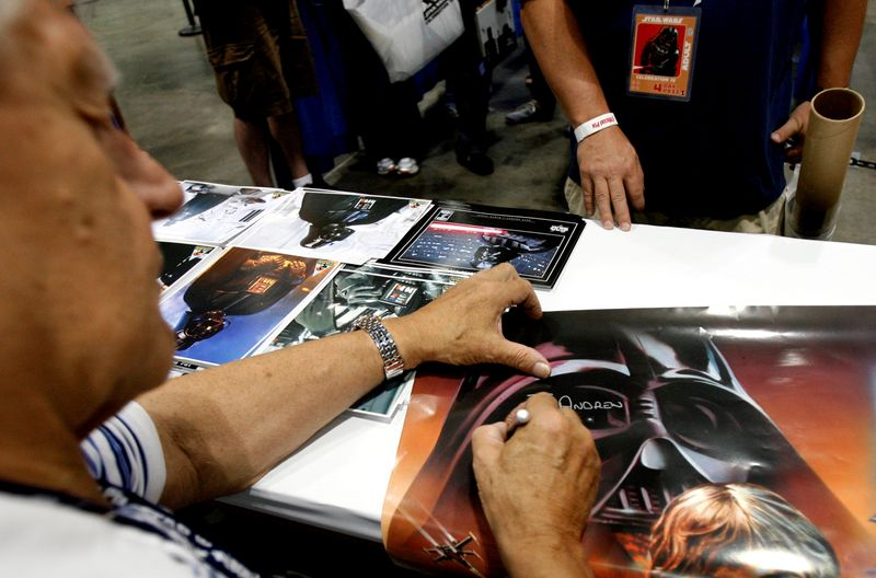 FILE PHOTO: David Prowse, who portrayed Darth Vader, signs autographs during the opening day of Star Wars Celebration IV in Los Angeles