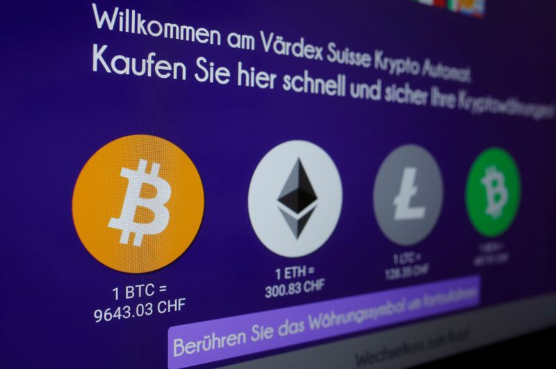 FILE PHOTO: The exchange rates of Bitcoin, Ether, Litecoin and Bitcoin Cash are seen on the display of a cryptocurrency ATM at the headquarters of Swiss Falcon Private Bank in Zurich