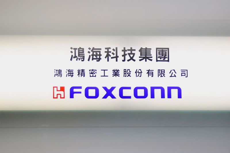 Sign of Foxconn is seen at a glass door inside its office building in Taipei