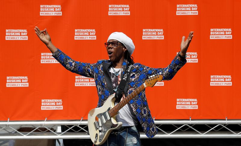 FILE PHOTO: Musician Nile Rodgers poses for photographs as he launches International Busking Day at Wembley Park, in London