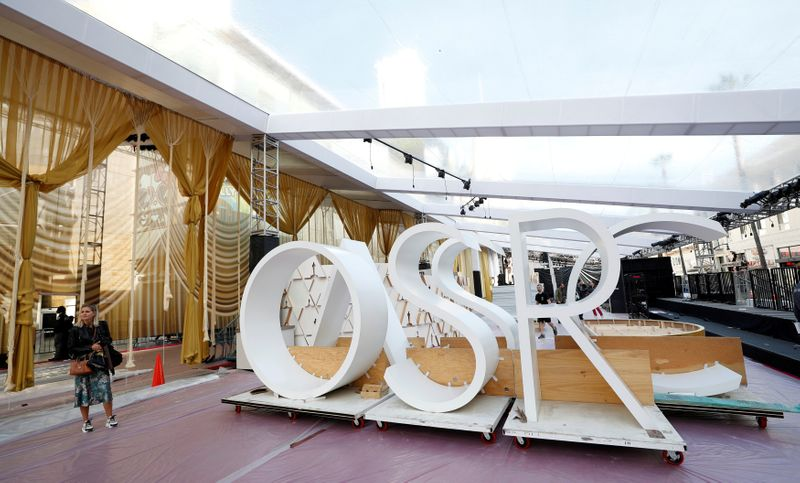 FILE PHOTO: Workers set up the red carpet area in preparation for the 92nd Academy Awards outside Dolby theatre in Los Angeles
