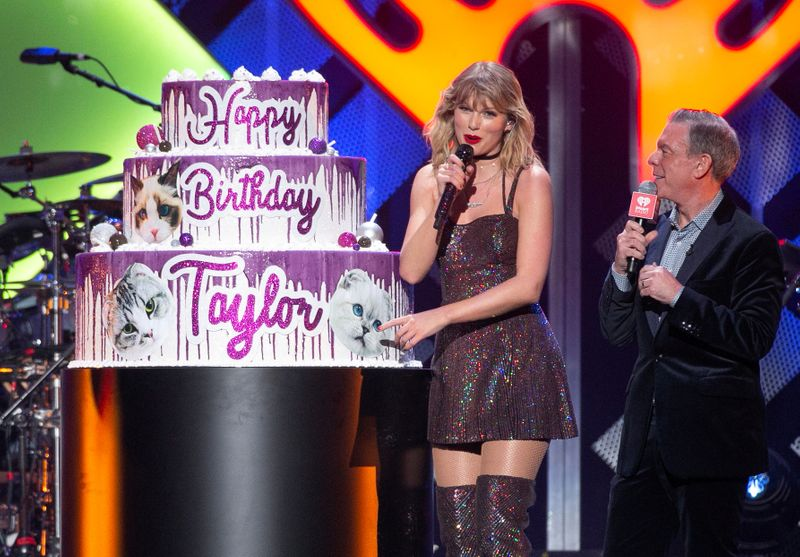 FILE PHOTO: Taylor Swift poses on her 30th birthday after performing during the iHeartRadio Jingle Ball concert at Madison Square Garden in Manhattan