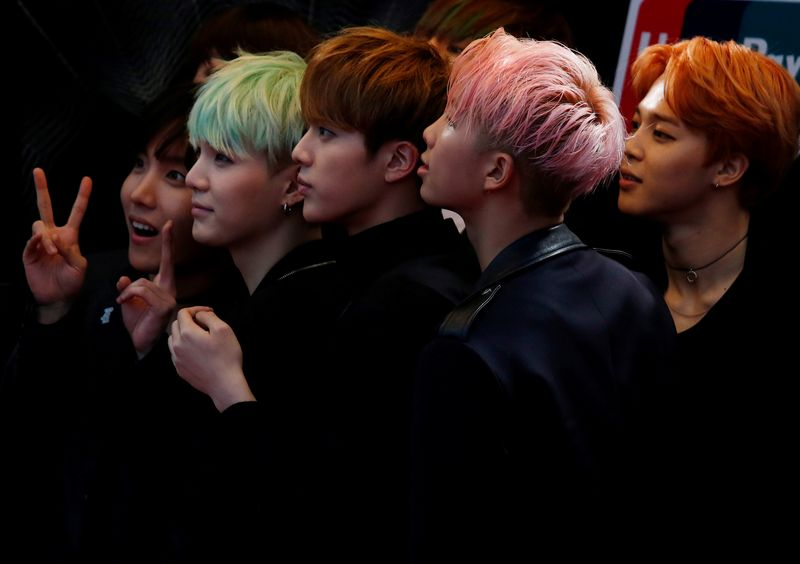FILE PHOTO: Members of South Korean K-Pop band BTS react on the red carpet during 2015 Mnet Asian Music Awards in Hong Kong