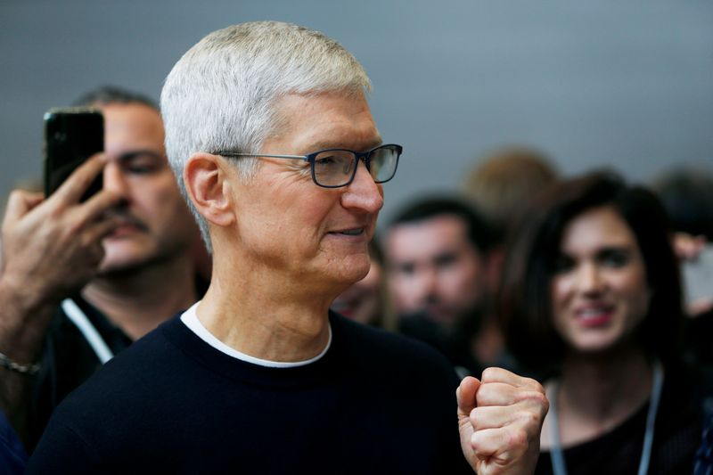 Apple CEO Tim Cook gestures during a product launch event in 2019