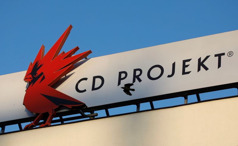 A bird flies in front of the Cd Projekt logo at its headquarters in Warsaw