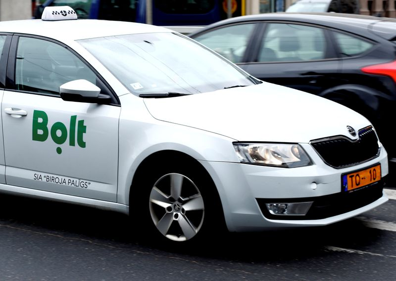 FILE PHOTO: A Bolt, formerly known as Taxify, sign is seen on the taxi car in Riga