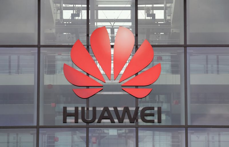 FILE PHOTO: Huawei logo is pictured on the headquarters building in Reading