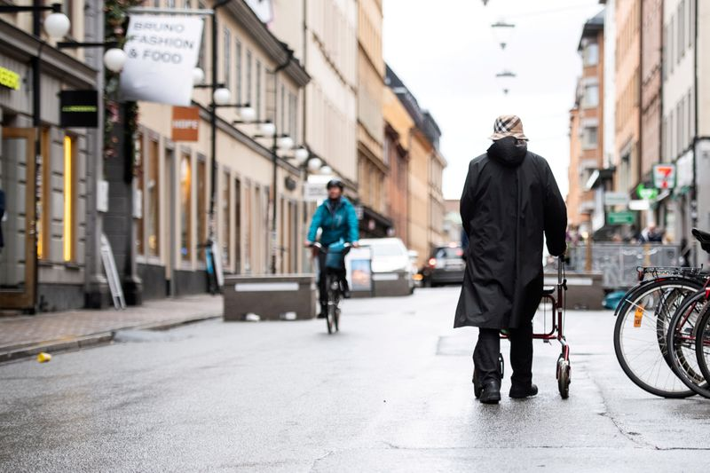 FILE PHOTO: Woman strolls through the Sodermalm area of Stockholm