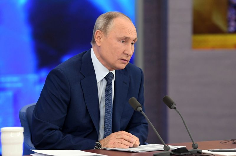 Russian President Vladimir Putin attends his annual end-of-year news conference outside Moscow