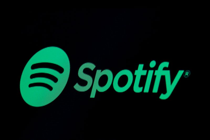 FILE PHOTO: The Spotify logo is displayed on a screen on the floor of the NYSE in New York