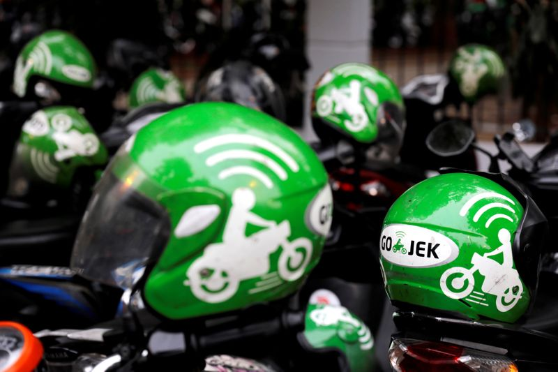 FILE PHOTO: FILE PHOTO: Gojek driver helmets are seen during Go-Food festival in Jakarta