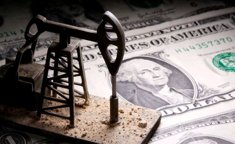 FILE PHOTO: A 3D-printed oil pump jack is placed on dollar banknotes in this illustration picture