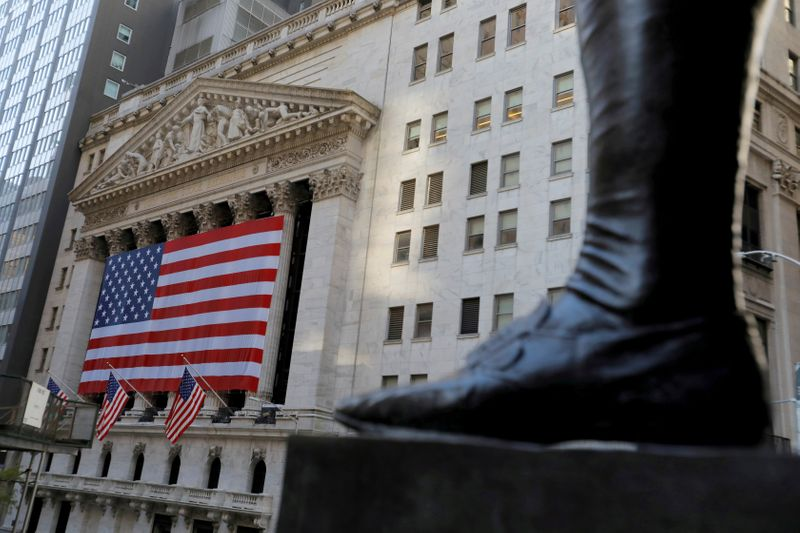 FILE PHOTO: The boot on the statue of former U.S. President George Washington is seen across the New York Stock Exchange (NYSE) following Election Day in Manhattan, New York City