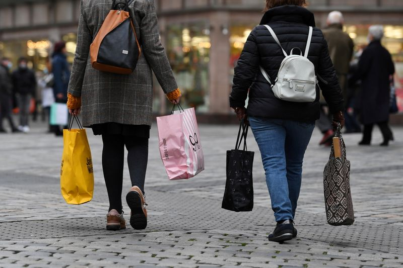FILE PHOTO: Women with shopping bags walk through the city center in Nuremberg