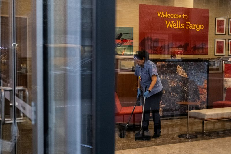 FILE PHOTO: A staff cleans the lobby inside Wells Fargo bank in New York