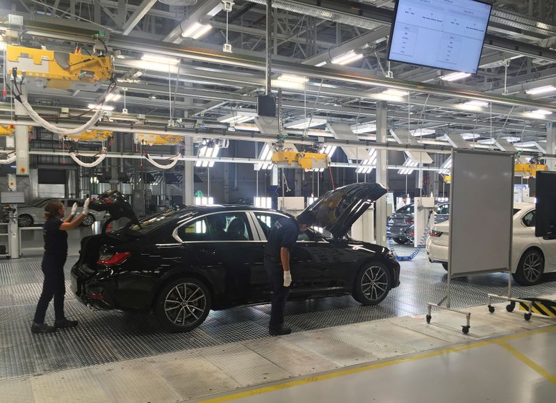 FILE PHOTO: Employees work on a BMW 3 Series car during a media tour at the new plant of German automaker BMW in San Luis Potosi