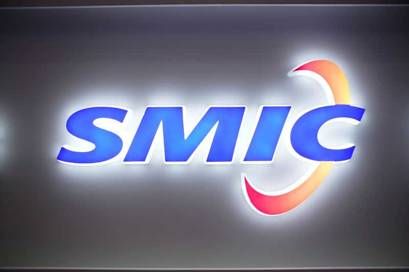 FILE PHOTO: A logo of Semiconductor Manufacturing International Corporation (SMIC) is seen at China International Semiconductor Expo (IC China 2020) in Shanghai