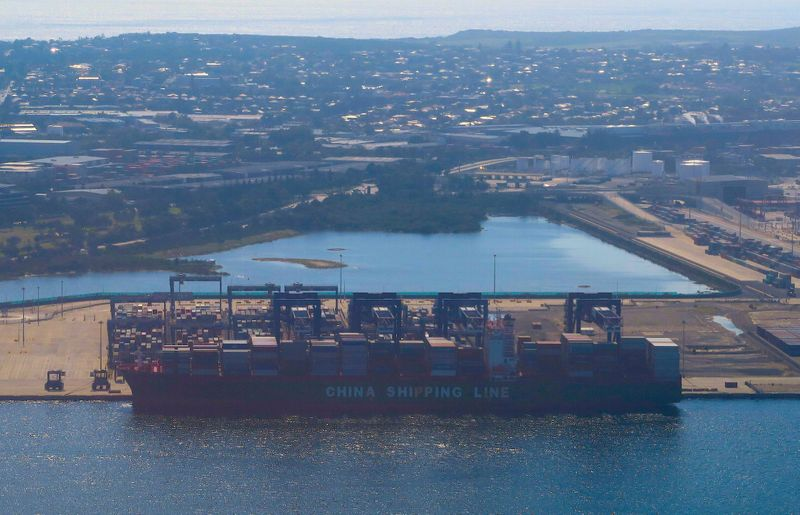 FILE PHOTO: A container ship is loaded with cargo at the Port Botany Container terminal in Sydney, Australia