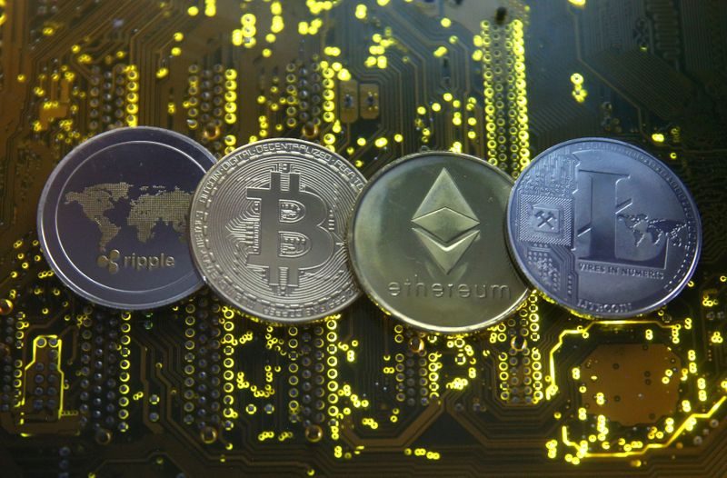 FILE PHOTO: Representations of the Ripple, Bitcoin, Etherum and Litecoin virtual currencies in an illustration picture