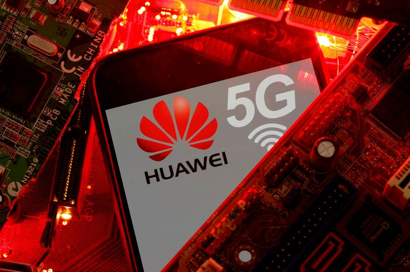 FILE PHOTO: A smartphone with the Huawei and 5G network logo is seen on a PC motherboard in this illustration