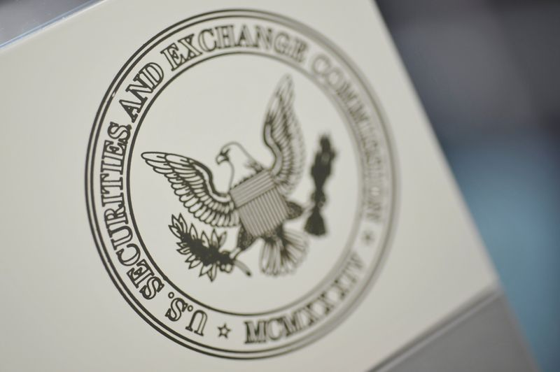 FILE PHOTO: The U.S. Securities and Exchange Commission logo adorns an office door
