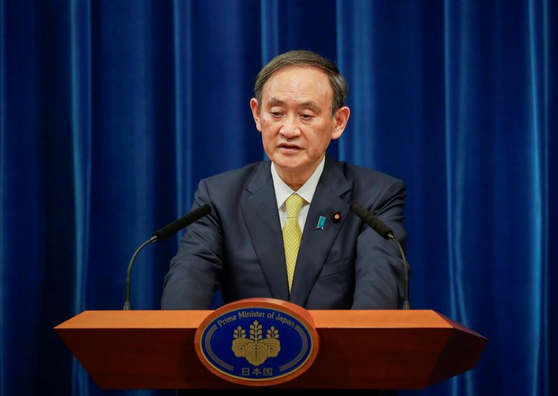 FILE PHOTO: Japanese Prime Minister Yoshihide Suga speaks during a news conference in Tokyo
