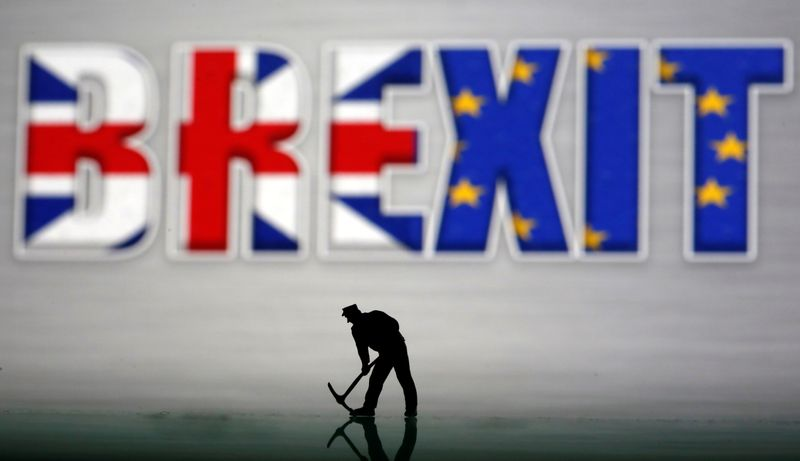 A small toy figure is seen in front of a Brexit logo in this illustration picture
