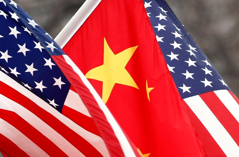FILE PHOTO: Chinese and U.S. flags fly along Pennsylvania Avenue outside the White House in Washington