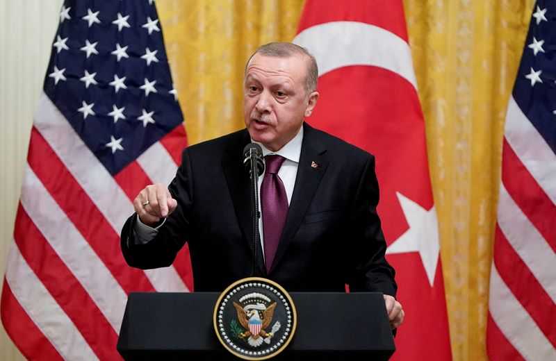 FILE PHOTO: Turkish President Tayyip Erdogan answers questions during a joint news conference with U.S. President Donald Trump at the White House in Washington
