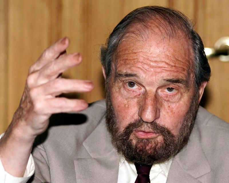 FILE PHOTO: Soviet secret agent George Blake gestures as he speaks at a presentation of a book of letters writte..
