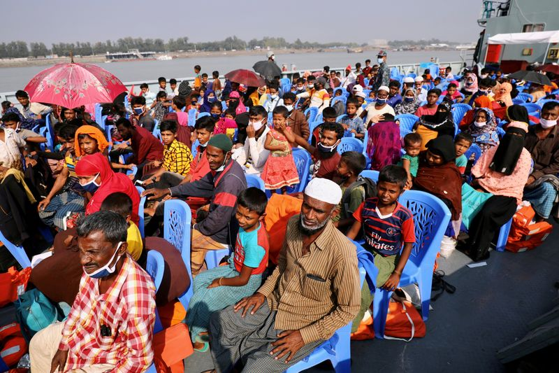 FILE PHOTO: Rohingya refugees are seen aboard a ship as they are moved to Bhasan Char island, Bangladesh