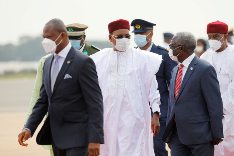 Niger's President Mahamadou Issoufou arrives at the airport for the Economic Community of West African States (ECOWAS) consultative meeting in Accra