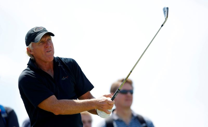 FILE PHOTO: Greg Norman of Australia watches his tee shot during a practice round ahead of the British Open Golf Championship at the Turnberry Golf Club in Scotland