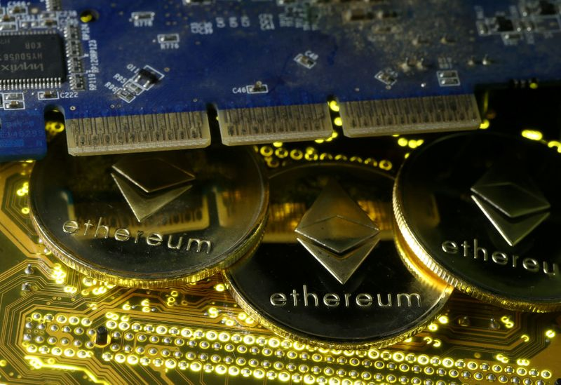 FILE PHOTO: Representations of the Ethereum virtual currency standing on the PC motherboard are seen in this illustration picture
