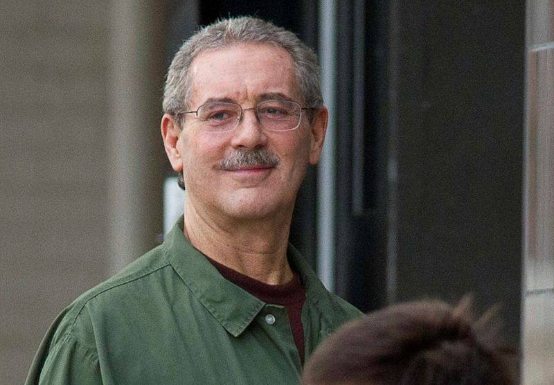 FILE PHOTO: Allen Stanford smiles as he waits to enter the Federal Courthouse where the jury is deliberating in his criminal trial in Houston