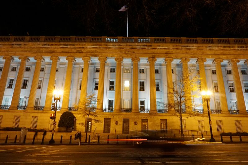 A vehicle drives past the U.S. Treasury Department in Washington