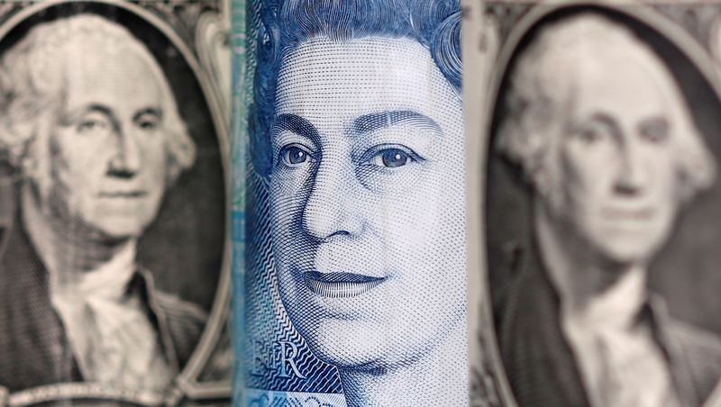 FILE PHOTO: Pound and U.S. dollar banknotes are seen in this illustration