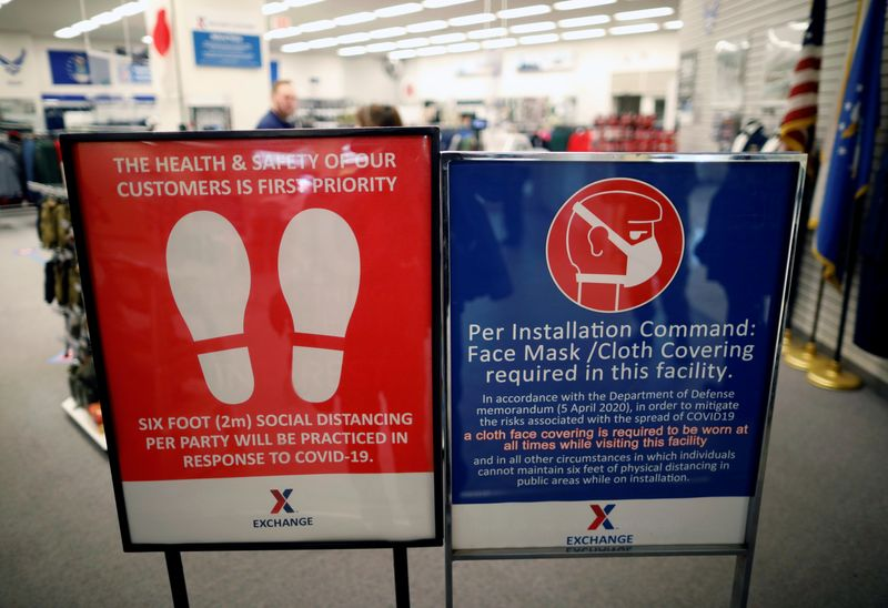 FILE PHOTO:  Caution notices for measures to prevent infection of the coronavirus disease (COVID-19) are displayed at Yokota U.S. Air Force Base in Fussa, Japan