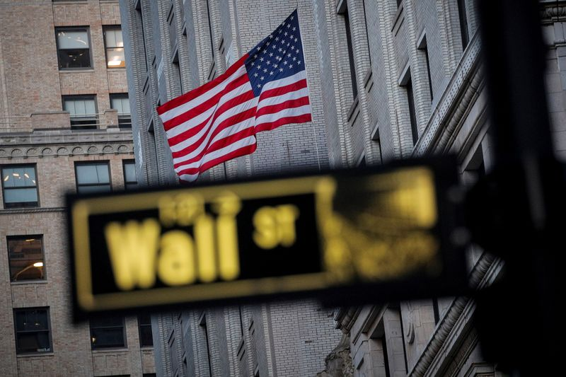 FILE PHOTO: The U.S. flag is seen on a building on Wall St. in the financial district in New York