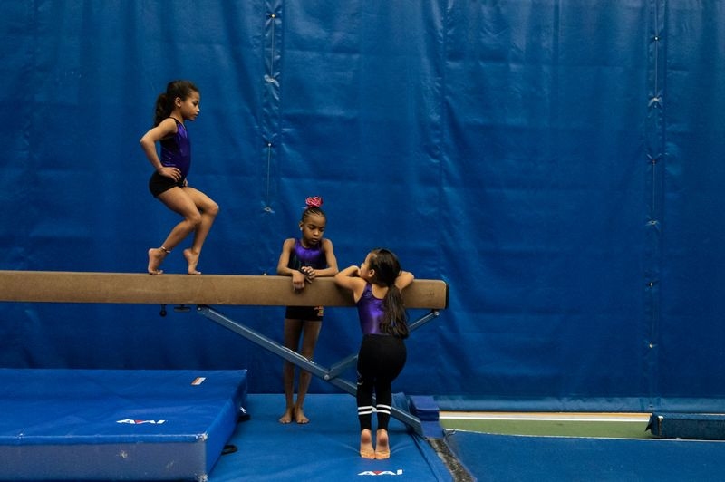The Wider Image: In Simone Biles' path, a fearless young gymnast learns new 2020 routine