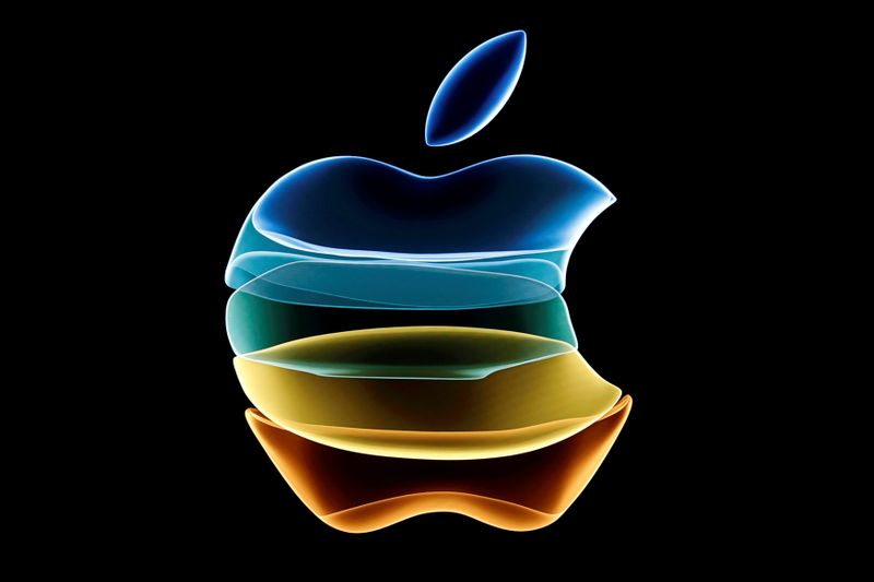 FILE PHOTO: The Apple logo is displayed at an event at their headquarters in Cupertino