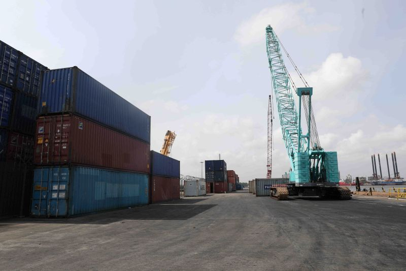 FILE PHOTO: Cranes and containers seen at APM terminal at Nigeria's gateway port in Apapa, Lagos