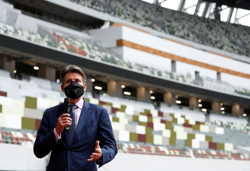 World Athletics President Sebastian Coe wearing a protective face mask speaks to media as he inspects the National Stadium, amid the coronavirus disease (COVID-19) outbreak in Tokyo