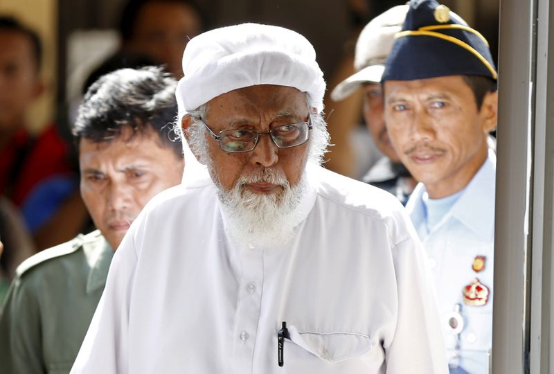 FILE PHOTO: Indonesian radical Muslim cleric Abu Bakar Bashir  enters a courtroom for the first day of an appeal hearing in Cilacap, Central Java province