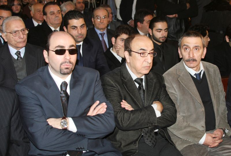 FILE PHOTO: Lebanese musicians and composers Ousama Rahbani, Elias Rahbani and Ziad Rahbani attend the funeral of Mansour Rahbani during a funeral in Beirut