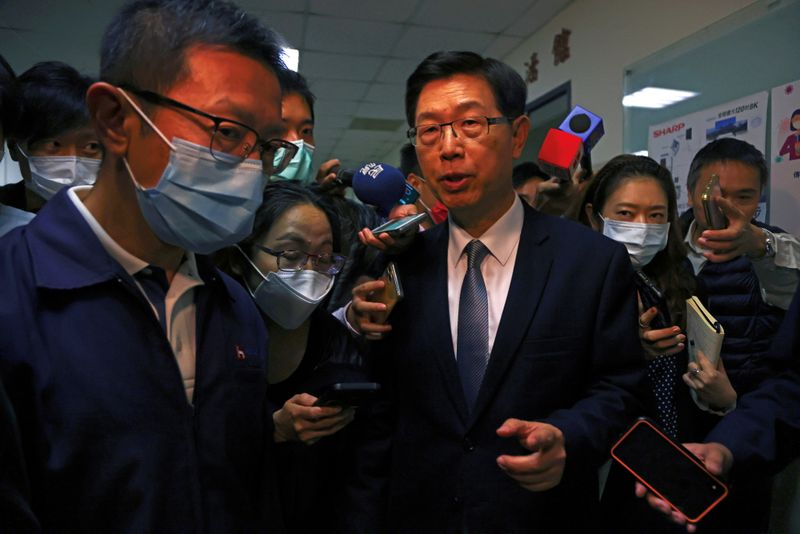 Foxconn Chairman Liu Young-way speaks to the media reporters after an investor conference at the company's office building in Taipei