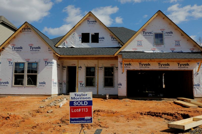 FILE PHOTO: A home under construction stands behind a